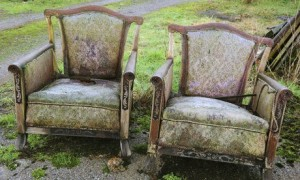 Rotting armchairs in street
